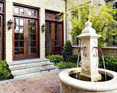Love this classic French fountain courtyard with herringbone brick...