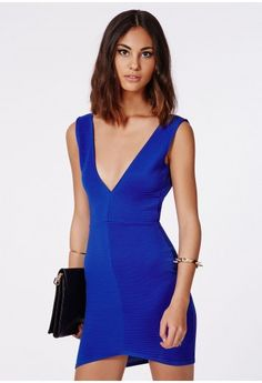 Set off the smokin' siren this season with this stunning cobalt blue bodycon dress. With its deep plunging V neckline, curved bottom cut and strong ribbed fabric this dress is super-hot. Style this beaut with strappy heels and a box clutc...