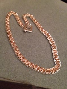 Viper basket weave in silver & rose gold filled rings with silver toggle clasp..