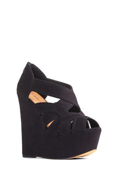 Debating between this and another pair. Hmmmm... do I want wedges or  booties with a heal?