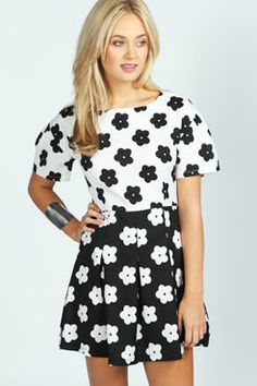 4de1bb2d724b4 Carrie Two Colour Floral Print Skater Dress at boohoo.com I want to buy it