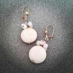 White earring by Hany Mustikasari