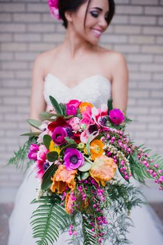 fuchsia and orange bouquet - photo by Barrie Anne Photography http://ruffledblog.com/mid-century-modern-spring-elopement #weddingbouquet #flowers #bouquets