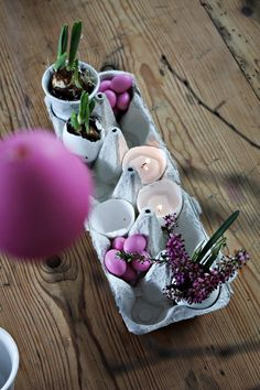 Table decoration made of eggs so sweet & the eggs w/ little bulbs are cute gifts to send home as gifts w/ family & friends.
