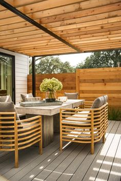 HGTV.com shows off the cool outdoor table of the HGTV Smart Home 2015 deck. The table on the back deck is made up of two small concrete tables that work together as one and offer a cool industrial vibe to this mostly wooden outdoor space.