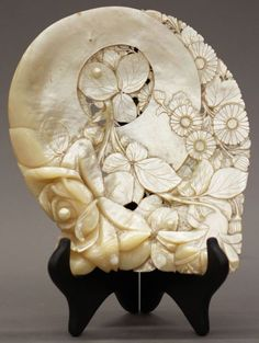 mother of pearl carving of flowers
