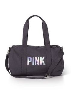 Going somewhere? The Mini Duffle Bag from Victoria's Secret PINK is the bag you need to carry your essentials. Perfect size for class, the gym and all your overnight adventures, in durable cotton with a front leather patch.