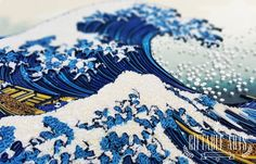 The Great Wave off Kanagawa is a woodblock print by the Japanese artist HOKUISAI. It is one of the best recognized works of Japanese art in the world. I have always love and love this art work and have seen many different interpretations from many different artists.  In this work, I tried to capture the enormous waves as well the awesome energy of it with paper quilling technique. It took a lot of hours but I hope that we have done the original print justice.   This piece of work is…