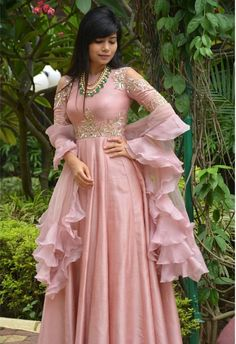 Designer Anarkali Suit of light pink colour with handwork on yoke. To customised such heavy garment log on to www.prasang,in