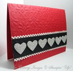 handmade Valentine card ... design with clean lines ... luv the bright red base with embossing folder design ... hearts punched from silver glitter paper ... Stampin' Up!