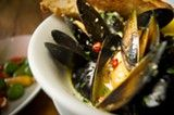 The mussels at The Cook and Her Farmer come in a garlicky beer broth.