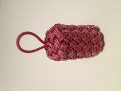 Globe knot around a wine cork in 2mm cord I got from rwrope.com.