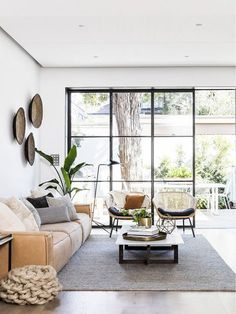 Light-filled living room featuring soft muted hues, natural materials and textures.