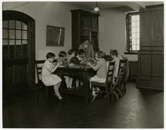 Perkins School for the Blind kindergarten girls in Nature Study in 1929. The girls sit at a table each exploring mounted animals including squirrel, rodents, a porcupine, rabbit, and a seal. Visit the Perkins Archives Flicker page: http://www.flickr.com/photos/perkinsarchive/collections/