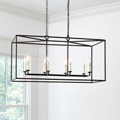 The big visual impact of our Hadley Rectangular Pendant comes from its architectural simplicity. The rectangular open frame is crafted of hand hammered iron with an eight candle-arm cluster and dark bronze finish. Pendant Chandelier, Chandelier Lighting, Light Pendant, Chandeliers, Dining Chandelier, Dining Room Lighting, Kitchen Lighting, Farmhouse Lighting, Open Concept Great Room
