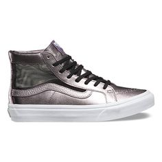 The Mesh Metallic Sk8-Hi Slim Cutout, a twist on the iconic Sk8-Hi, combines a slimmed down high top silhouette with metallic leather uppers, a cutout mesh panel, and signature rubber waffle outsoles.