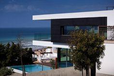 Portuguese architect Mario Martins designed this ocean view home in Lagos, Portugal.