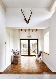 Herringbone floors, steel doors, antlers