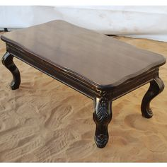 Add sophistication and elegance with the Lincoln Study Espresso Classic Coffee Table. The formal living room accent table is made of solid Indian Rosewood. It is colored with a dark mahogany stain which brings out a subtle wood grain pattern. The coffee table has rounded corners and cabriole legs with pad feet.