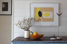 A Cottage Reborn in Rural Maine Remodelista - contemporary composition - colorful art adds warmth