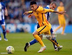 Barcelona's Brazilian forward Neymar vies with Deportivo La Coruna's midfielder Alex Bergantinos during the Spanish league football match RC...