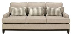 I am selling our 3 cushion sofa from Ashley furniture. Purchased a year ago from Ashely. We are selling it to get a sectional which fits better in our new home. Non smoking. We do have a cat but the couch is clean and no hair on it. Has a couple of knicks on the bottom trim from the vacuum bumping it, but easily fixable with furniture pen. Excellent condition. It is a kahki, tweed like fabric, but the fabric is soft. Comfortable. All cushions can be removed to rotate and clean. ...