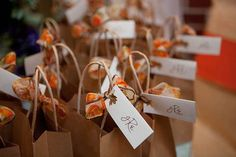 Bags of Halloween candy as favors at an October wedding
