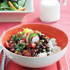 An absolutely amazing black bean and rice dish. DO take time to use the garnishes. They add tremendous flavor and texture.