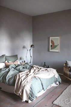 Minimalist room paint colors can make a subtle space feel textured. So if you want to add intrigue to your home without adding extra stuff, invest in a can of paint.
