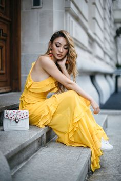Tier Dress and Sneakers = 8 Pieces To Achieve The Modern Romantic Look // NotJessFashion.com // yellow summer dress, yellow sundress, ruffle dress, maxi dress, yellow maxi dress, dress with sneakers, feminine fashion, romantic style, flirty style, summer outfit, spring outfit, fashion and travel blogger, new york fashion blogger, asian blogger, jessica wang #ootd #fashioninspirations #yellow #ootdmagazine #shopmycloset #wiwt #outfits #fashionblogger