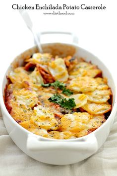 Chicken Enchilada Potato Casserole - Chicken, corn and black beans mixed in a beautiful enchilada sauce and topped with a layer of thin sliced potatoes.