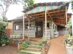 Using recycled plastic drink bottles, one man has created an entire house. I would build a small shed and green house.