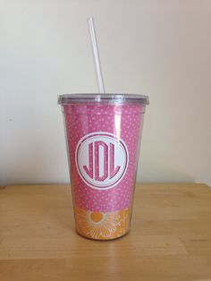 Adorable monogrammed insulated acrylic tumbler, with straw. Three cup colors available, pink w/ orange, orange, and green w/ light pink.