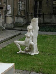 Sculpture - woman giving birth under tree