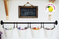 Love the buckets on the rod. They look a lot like the IKEA Fintorp line! How to organize the home office | A Bowl Full of Lemons
