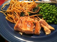 Pan-Seared Mahi Mahi served with whole wheat noodles and peas