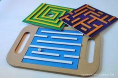 I love these DIY cardboard mazes great for improving coordination Diy Toys And Games, Diy For Kids, Crafts For Kids, Cardboard Play, Carton Diy, Paper Toy, Indoor Activities For Kids, Cardboard Furniture, Building For Kids