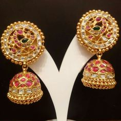 Jadau Collection - Traditionally designed Antique Peacock Jhumkas studded with diamond polkies and rubies.Available Only @ NAJ Call or WhatsApp @ 9032041323 India Jewelry, Temple Jewellery, Gold Jewelry, Saree Jewellery, Diamond Jewellery, Jewellery Box, Gold Earrings Designs, Necklace Designs, Gold Designs