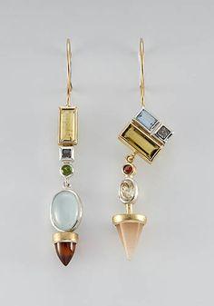 "Janis Kerman: , Earrings in sterling silver, 18k yellow gold, yellow and green tourmaline, industrial diamond, spessartite garnet, aventurine, zircon, and garnet. Approx 2 1/2"" long."