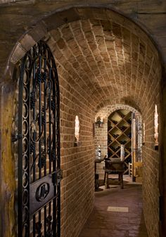 Cool barrel vaulted hall to wine cellar. Neat gate too!