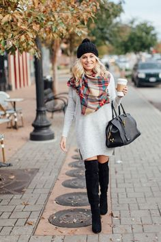 Pair a sweater dress with an over-the-knee boot, a scarf and a beanie for ultimate street style.