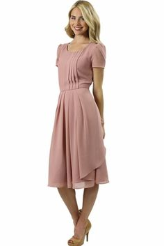 The Cassidy dress in a beautiful cameo rose pink features front pleats and a multi layer wispy skirt. Elegant and classy, it's the perfect dress for Easter, weddings, and any other special occasion. Cassidy Modest Dress in Cameo Pink