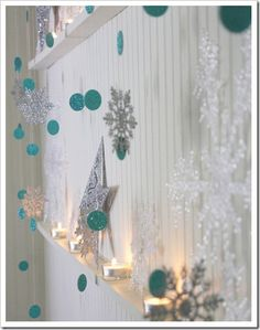 """easy backdrop - glittery (or any other type according to your preference/theme) cardstock, hot glue, 1-2"""" circle punch, and thread"""