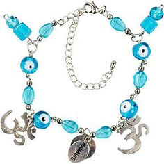 """Evil Eye Adjustable Bracelets Om Namaste Aqua - This lovely bracelet is made from glass and metal beads and features four aqua evil eye beads, two silvery Om charms and a center """"NAMASTE"""" inscribed bead. Each adjustable bracelet has a lobster claw clasp and 2 inch extension chain. Bracelets are attached to Evil Eye Amulet cards which describes the protective powers of this talisman."""
