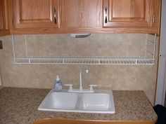A wire shelf suspended from your kitchen cabinets gives you additional counter space.  Also great over bathroom sink for extra space while camping.  Great while you are parked--store everything when traveling.