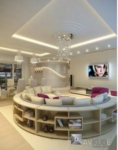 A glamorous but modern seating area is suffused with a combination of lighting effects, including #spotlights and concealed #striplights #loungelighting