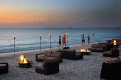Use the tiki torches to define the edge of the private party space.  #barefoot #beach #bonfire