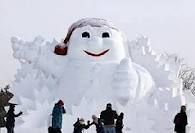Tourists pose near a snowman sculpture during the Harbin International Ice and Snow Festival at a park in Harbin, Heilongjiang province, China early in Funny Snowman, Make A Snowman, Frosty The Snowmen, Christmas Snowman, Christmas Humor, Snowman Images, Snowmen Pictures, Winter Wonder, Winter Fun