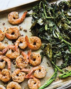 Shrimp and broccoli rabe cook on the same baking sheet for an easy one-pan dinner.