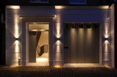 New mews house on vacant plot in Kensington by John Cullen Lighting